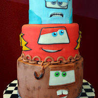 Melty Mater  For my little boy's fourth birthday! He LOVES the Cars 2 movie, so I did this with the bottom tier as Mater, the middle as Lightning...