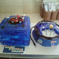 Gamecube Cake With Controller On Another Small Cake Gamecube cake with controller on another small cake.