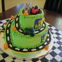 Race Track Cake 10 and 6 inch cakes covered in BC with fondant accents. I got the idea from a few different CC members (thank you!) This was my first...