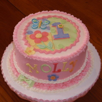 "1 Yr Old Birthday Cake Just a fast, simple birthday cake for my one year old Grandaughter. It is an 8"" round, vanilla cake, with buttercream frosting...."