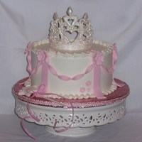 A Simple Princess Cake With Buttercream Icing Fondant Decorations And Fondant Tiara With Royal Icing A simple Princess Cake with buttercream icing, fondant decorations, and fondant tiara with royal icing.