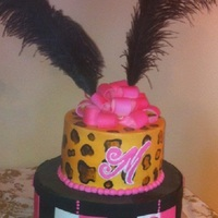 "Leopard Print And A Hat Box.  12"" White Almond Cake with Strawberry filling and Almond Buttercream. 8"" Chocolate Cake with Chocolate Buttercream for the..."