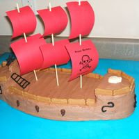 Pirate Ship  Yellow cake frosted with chocolate buttercream. Royal Icing accents. Really wanted to make the sails out of white Chocolate but it was just...