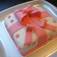 Pink Bow Birthday Cake My second cake for a family members birthday. White cake with almond bc and pink fondant bow. Also used edible glitter on the bow and...