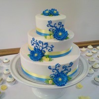 Blue Gumpaste Daisies  This lovely number was 3 tiers of fudge marble with a whipped raspberry mousse filling and buttercream frosting. The flowers are completely...