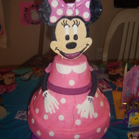 Minnie Mouse  I made this cake for my daughters 3rd B-day. Minnies dress is all buttercream with fondant dress accents. Her head, arms and hands are...