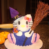 Halloween Hello Kitty  Halloween Hello Kitty made with the bear pan for my daughters 4th B-day. White cake and buttercream frosting. Broom and hat are not edible...