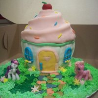 My Little Pony Cupcake House   Giant cupcake mold. Covered in fondant with a blueberry cream cheese filling. Made it for my daughters 5th b-day.