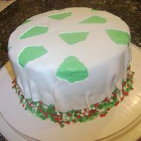 Christmas Tree Confetti Cake  This is just a chocolate cake with a candy cane buttercream frosting. Fondant draped over the top and christmas colored sprinkles on the...
