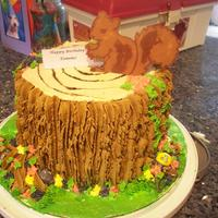 Tree Stump Cake With Squirrel   Chocolate cake with chocolate buttercream frosting. Squirrel was made from chocolate. For my sister who is a nature lover.