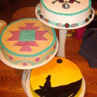 Native American Indian Birthday Cake  These are three cakes all with an Indian theme. The top cake is a German Chocolate cake with candy rock necklace covered in buttercream....