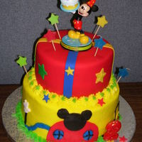 Mickey Mouse Birthday Cake 8 & 6 inch layers, bottom layer buttercream, top layer fondant. Mom provided topper. TY for looking