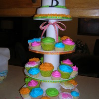 Graduation Cupcake Stand Made this cupcake stand for a young lady's graduation. She wanted cupcakes in neon colors. Found the silk flower and black plastic...