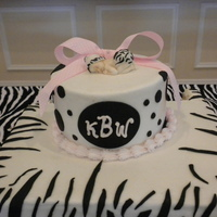 "Zebra Baby Shower Cake 10 inch square and 6 inch round - buttercream icing with fondant zebra stripes. The baby is made from gumpaste. Customer wanted ""baby&..."