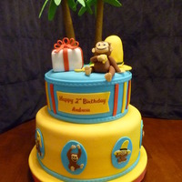 Curious George B-day cake for friend's 2 yr old who loves Curious George. Yellow cake. Palm tree leaves and George are Gum paste, Hat & present...