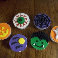 Halloween Cucpcakes These were actually styrofoam cupcakes using royal icing that were done for a display for a gluten free store that I decorate cakes and...