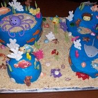 Under The Sea Cake iced in buttercream, nilla wafer crumbs for the sand, MMF & white chocolate for sea creatures, some dusted with color & pearl...