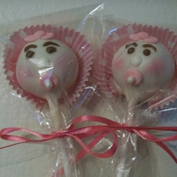 Baby Face Cake Pops Cake pops dipped in white chocolate then placed in mini cupcake liner for bonnets. Made pacifiers out of fondant and attached a sugar pearl...