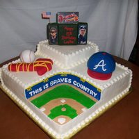 Atlanta Braves/turner Field Cake was done in buttercream with scoreboard, baseball hat, baseball and tomahawk were done in RKT and covered with fondant. Back of the...
