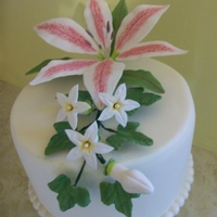 Stargazer Lily Cake was covered in fondant with a fondant bead border that was dusted with pearl dust. Stargazer lily, stephanotis & bud and ivy...