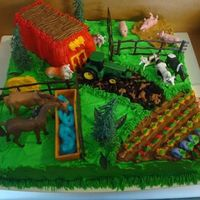 Barn Cake The lady that picked out this cake saw some of the earlier cakes that I made, and liked one of the barn cakes! The farm animals came in a...