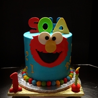 Elmo 8 x 8 inch chocolate cake with chocolate filling .