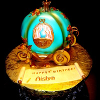 Cinderalla Carrige Cinderella's carriage . Almond cake with butter cream filling and fondant icing .