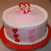 Valentine's Day Buttercream with fondant hearts. Made as a donation cake for a raffle for the local hospital. Was very happy to help raise $750.00!TFL!