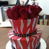 Sweet 16 Cake Tailored cakes with buttercream and fondant silver zebra striped. The 16 was dusted in silver but wound up taking it off since the roses...