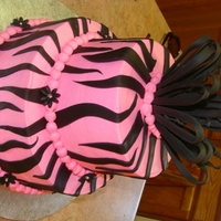"Hot Pink With Zebra Stripes This was a graduation cake, 6 and 9"", buttercream with fondant accents. No idea why I can't rotate it... :)"