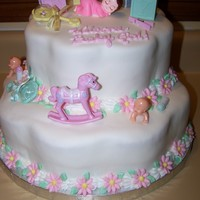 Baby Shower Cake Marshmallow fondant with fondant flowers and plastic toys - I love the petal pan!