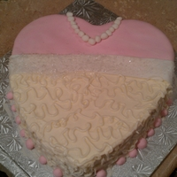 Heart Shape Bridal Cake Key lime flavored, cream cheese iced, heart shape cake. Decorated in wedding colors.