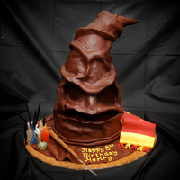 Harry Potter Sorting Hat   This sorting hat is about 2' tall. Three quarters Mudcake and 1/4 rice crispy.The bottles are hand made from sugar.