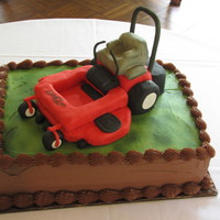 Lawnmower Groom's Cake   9x13 layer cake with rice krispie fondant covered Lawnmower