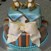 "Twin Giraffe's   Baby shower cake for twins... buttercream iced cakes with fondant decorations...... ""sixlets"" candy used for borders"