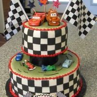 Cars   Black fondant squares used to make the black and white side design... real cars and plastic flags.