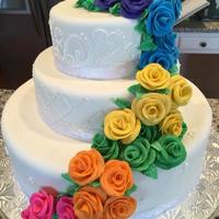 Cascade Of Roses Fondant covered cake with rainbow colored fondant roses.