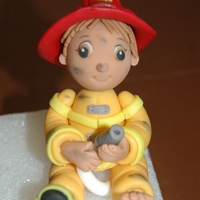 Fireman Fireman figure made from fondant/tylose for a cake I am working on for a 2 year old boy. He likes to go barefoot so I thought it would be...