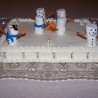 Snowmen Around A Fire I did this cake for a christmas party. for some humor, i burnt one of the snowmen.