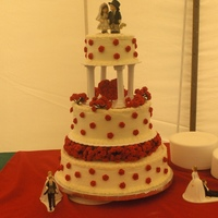 My Wedding Cake I made this cake for my wedding. Mini red roses fill the space between the tiers, as well as cover the surface of the cakes. I also made a...
