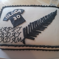New Zealand All Blacks Cake Made this for a friends 30th Birthday. His fav team is the New Zealand All Blacks. Covered in buttercream with mmf as the fern and jersey...