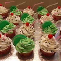 Margaritas And Sundaes! Vanilla cupcake with buttercream icing. Red gumball for the cherry and brown sprinkles for the Sunday and Green Jelly Limes and green sugar...