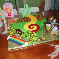 Wizard Of Oz Cake Made this for my daughter's 4th birthday on her request for an Oz cake. All buttercream, candy coated pretzel rods for emerald city...