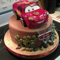 "Lm Birthday Cake 10"" round strawberry w/ choc. ganache, car is orange cream w/ white choc. ganache."