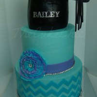 Chevron Graduation Cake Blingy graduation cake. Chocolate cake with caramel filling and strawberry cake with strawberry cream filling. Accented with fondant and...