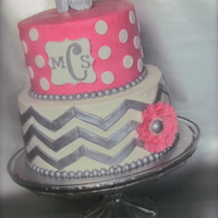 Chevron Polka Dot Monogram Cake I made this for my daughter. Chevron is some tricky stuff. Flower is gumpaste with a fondant ball center, outlined with pink pearl dragees...