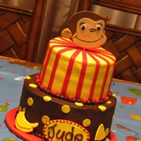 Curious George Top tier is Strawberry Cake with Cream Cheese filling, bottom tier is Dark Chocolate Fudge Cake with Chocolate Ganache. If I had this one...