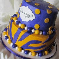 Lsu Girly Cake Top tier is Strawberry Cake with Cream Cheese filling, bottom tier is Dark Chocolate Fudge cake with Chocolate Ganache filling. A white...