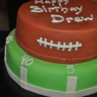 "Football Theme Cake  Pound cake with mmf made for my sons 12th birthday. Someone told me a couple of days later that I forgot the ""d""in birthday......."