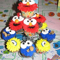 Sesame Street Character Cupcakes I made these for my nephew's 2nd birthday because he loves Elmo! Thanks Jen411 for your tips and the amazing inspiration! Next time I...